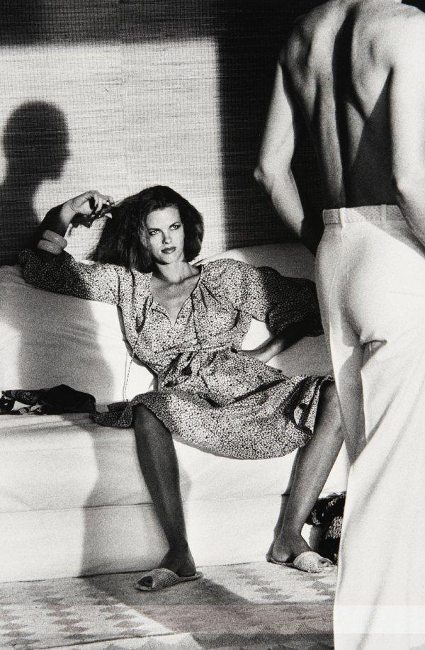 Woman Examining Man by Helmut Newton