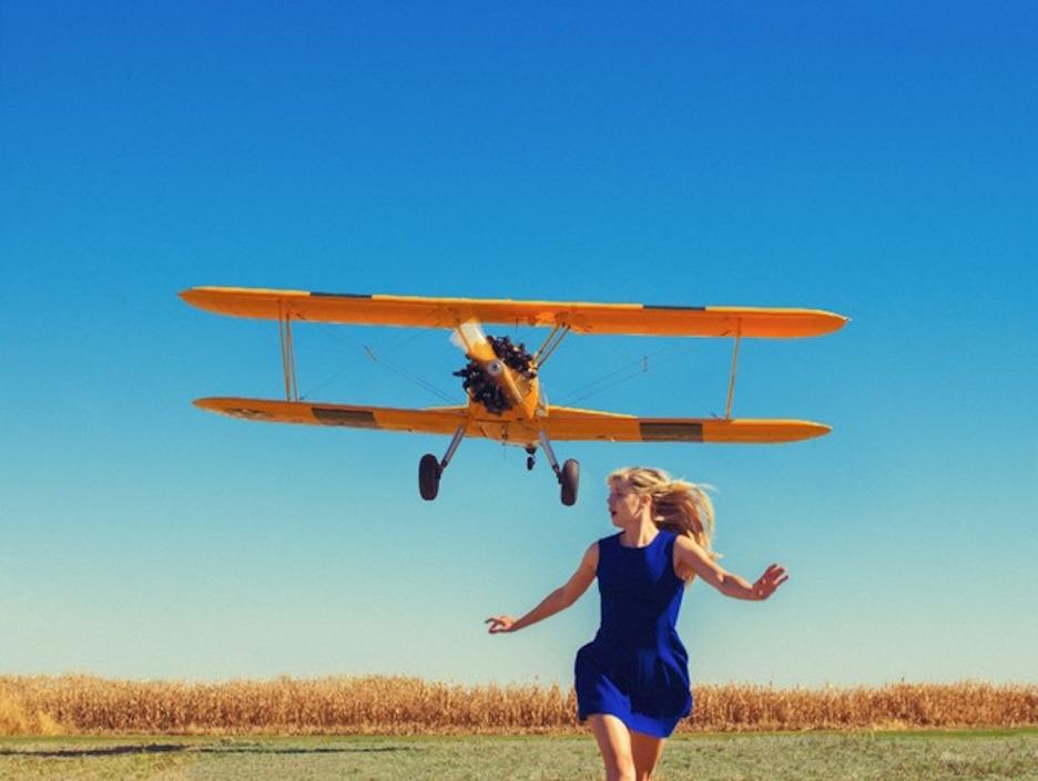 Girl Running from Plane by Tyler Shields