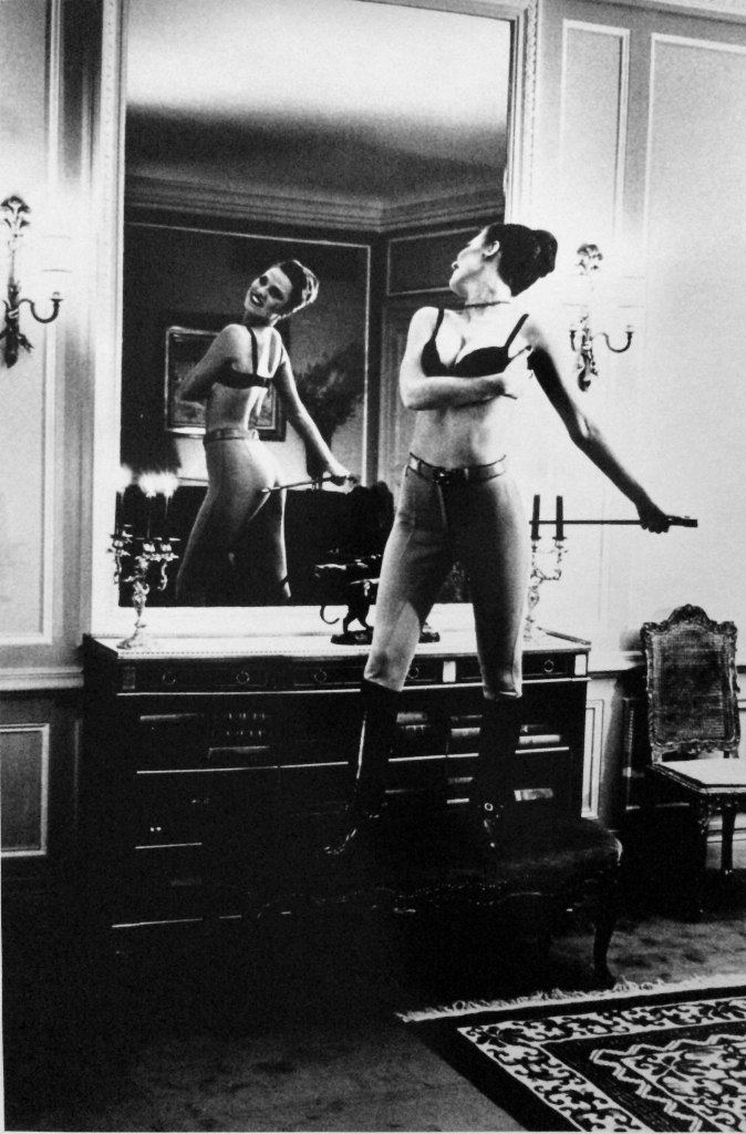 Riding crop and mirror by Helmut Newton